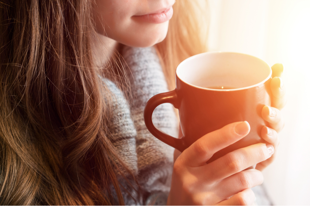 woman drinking tea from best induction kettle