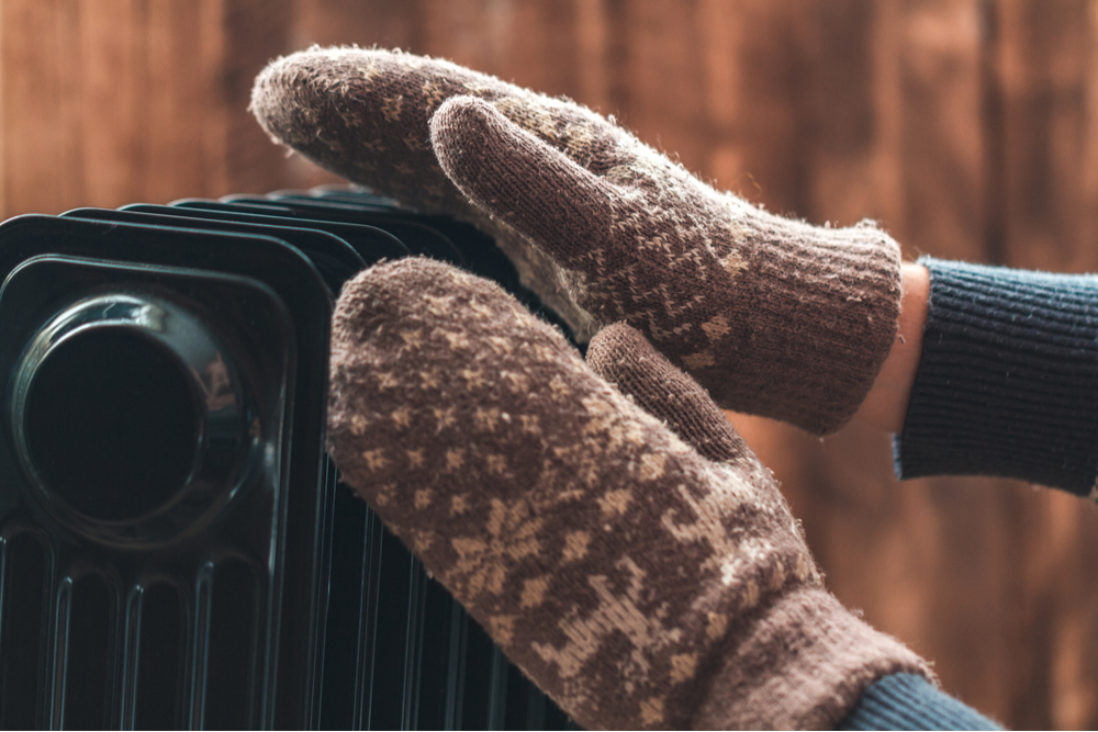 Warming hands on best electric radiator