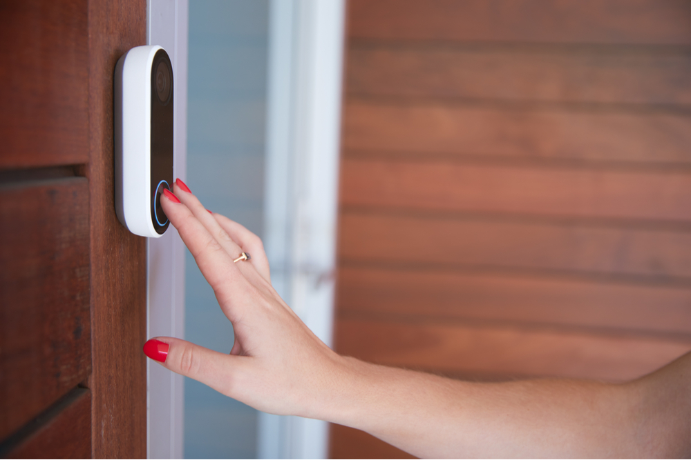 woman ringing best wireless doorbell uk