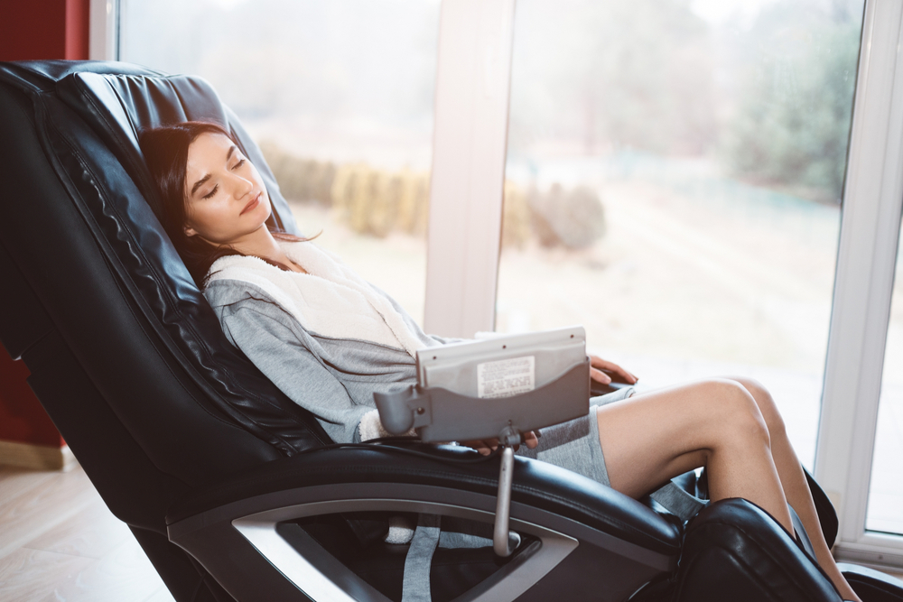 woman relaxing in best UK massage chair