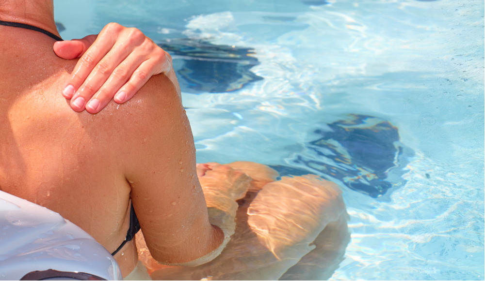 woman sitting in best inflatable hot tub