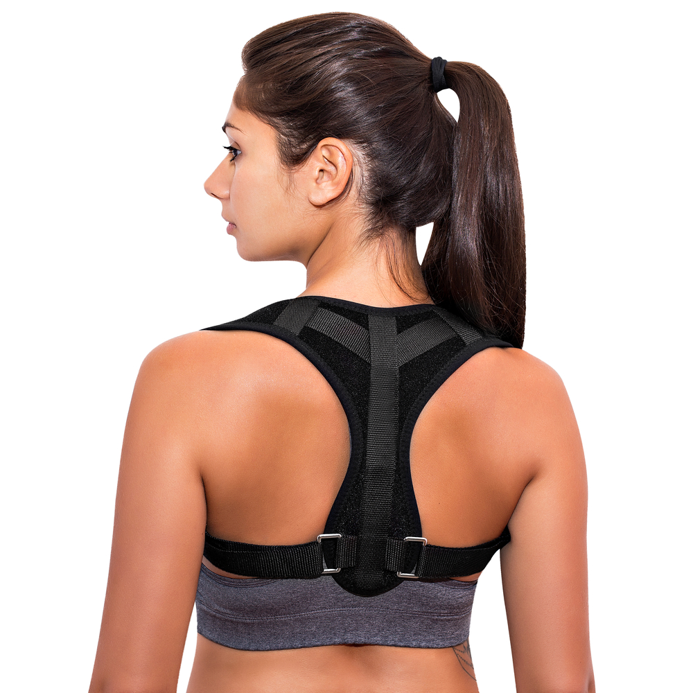 woman wearing best posture corrector uk