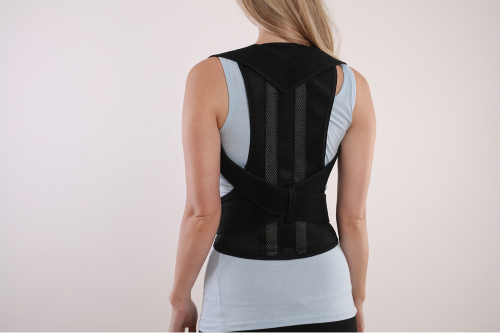 woman in best posture corrector uk