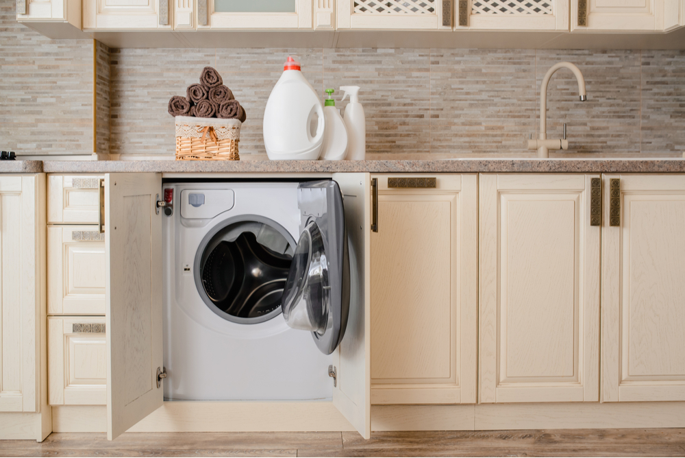 best integrated washing machine in cream kitchen